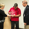 Globe/Roger Nomer<br /> Jen Black, executive director of The Alliance of Southwest Missouri, shows the organization's appreciation of support during One April to Randy Dixon, painter at Mercy Hospital, and Gary Pulsipher, president and CEO of Mercy Hospital Joplin, on Tuesday at Mercy Hospital. The One April event sought to raise awareness and prevention of child abuse in the area. Dixon painted a large pinwheel on Mercy Hill in support of the event.