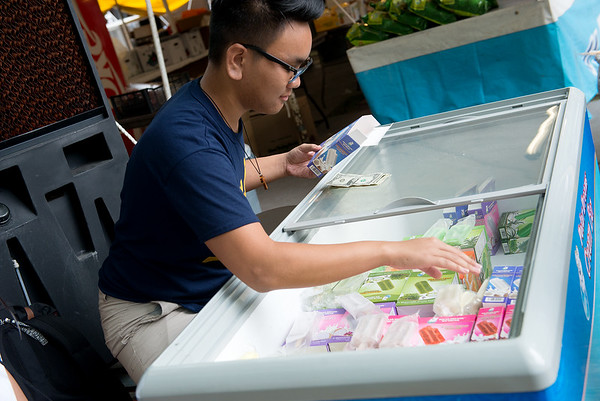 Globe/Roger Nomer<br /> Justin Nguyen, Houston, sells ice cream at Marian Days in Carthage on Tuesday.