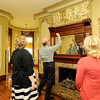 From the left: Ashley Weddle, Joplin Museum Complex Director Brad Belk and Kate Kelley look at a terra cotta display of dancing cherubs inside the Schifferdecker House on Tuesday.<br /> Globe | Laurie Sisk