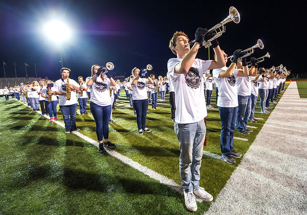 Webb City senior trumpeteer Skyler Johnston, center, joins 10 other bands at halftime of the Missouri Southern football game during Mass Band Day on Thursday night at Fred G. Hughes Stadium.<br /> Globe | Laurie Sisk
