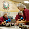 Globe/Roger Nomer<br /> (from left) Taylor Mercer, a College of the Ozarks sophomore from Houston, Taylin McCoy, a sophomore from Stillwater, Okla., and Cara Pemberton, a senior from Bergman, Ark., work in the Fruitcakes and Jelly Kitchen on Thursday.