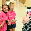 From the left: Six-year-old triplets Addison and Lauren Harper pose with their kinderrgarten teacher Nicole Thorn as their mother, Jayme Harper, takes a photo of their first day of school on Thursday at Jefferson Elementary.<br /> Globe | Laurie Sisk