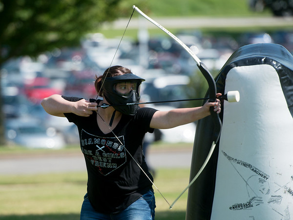 Globe/Roger Nomer<br /> Sam Smith, a Missouri Southern junior from Rogersville, takes aim during a game of Archery Tag on Thursday at MSSU.