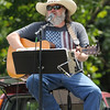 Lonnie Hulett entertains the crowd during the Four States Armed Forces Music Festival on Saturday at Morse Park in Neosho. Proceeds from the event will benefit area veteran's organizations.<br /> Globe | Laurie Sisk