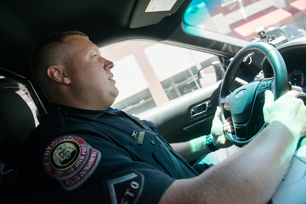 Globe/Roger Nomer<br /> Joplin Police Officer Logan Rivers patrols in a Joplin Police Ford Explorer on Wednesday.