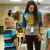 Globe/Roger Nomer<br /> Jennifer Daniels talks with her incoming first-grade students Jaykin Snider, left, and Breck Patrick during Monday's open house at Goodman Elementary.