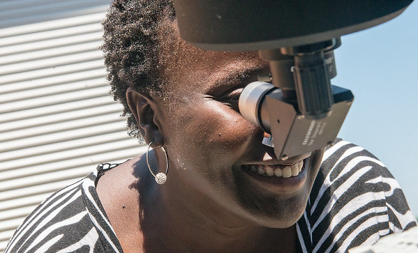 Globe/Roger Nomer<br /> Joan Aura, Joplin, looks a the solar eclipse on Monday at the Joplin Public Library.