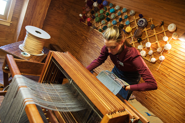 Globe/Roger Nomer<br /> Hannah Deal, a College of the Ozarks junior from Clarmore, Okla., demonstrates a loom at the Edwards Mill on Thursday.