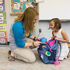 Globe/Roger Nomer<br /> Stephanie Wellesley helps her kindergarten student Laiken Rogers unpack during an open house on Monday at Goodman Elementary.