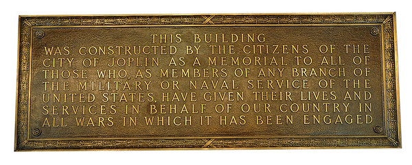 A plaque hanging in the lobby of Memorial Hall details the original purpose of the building.<br /> Globe | Laurie Sisk