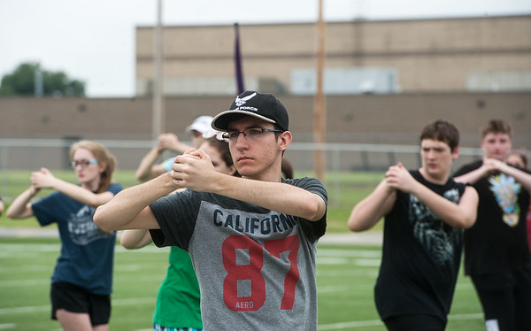 Globe/Roger Nomer<br /> Pittsburg High School band member Blake Cunningham, senior, practices drills on Monday at Hutchinson Field.