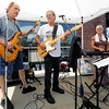 From the left: Cliff Walker, Max Barnett and Deborah Barnett, of The Catalyst Band, entertain the crowd during Hideout Harley-Davidson's 2017 Local Heroes Appreciation Day Car and Bike Show on Saturday at Hideout Harley-Davidson. The benefit event was a chance to show appreciation to local emergency personnel and raise money for charities chosen by police, fire and EMS, including the Muscular Distrophy Association and the Shop with a Cop program, which provides Christmas presents for children in need.<br /> Globe | Laurie Sisk