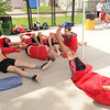Webb City swimmers try to relax as they wait out a long delay before the start of the JAC Invite on Thursday at Schifferdecker Pool.<br /> Globe | Laurie Sisk