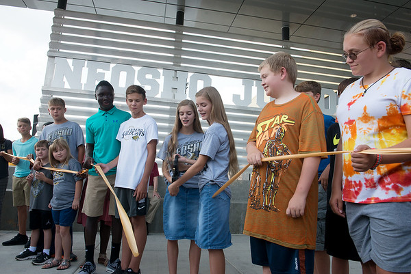 Globe/Roger Nomer<br /> Neosho Junior High student cut the ribbon on their new school on Thursday afternoon.