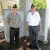 American Legion Post 13 veterans Richard Russell, left and Tod Thompson stand in front of a memorial to WWII veterans outside Memorial Hall on Thursday.<br /> Globe | Laurie Sisk