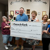Globe/Roger Nomer<br /> Jim Zerkel, president of the Kiwanis Club, center, presents a $6,000 check to the Cerebral Palsy of Tri-County in Webb City with (from left) Mechele Coppenbarger, infant instructor, Jr. Ballard, 2, Christy Graham, executive director, Shelly Keeling, center director, and Vincent Wilkowski, 1, on Tuesday at the Center.