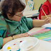 Globe/Roger Nomer<br /> Tina Kimball, Webb City, paints during a Memories in the Making class on Thursday at Spiva Center for the Arts.