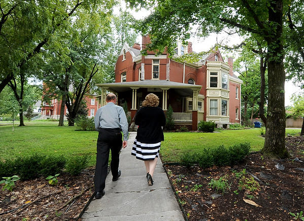 Joplin Museum Director Brad Belk, left and Ashley Weddle walk toward the entrance of the stately Zelleken House on Tuesday.<br /> Globe | Laurie Sisk