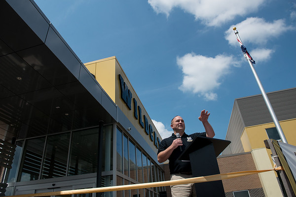 Globe/Roger Nomer<br /> Steven Douglas, school board president, welcomes the crowd before Thursday's ribbon cutting at the new Neosho Junior High School.