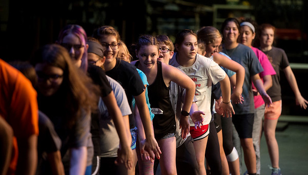 "Globe/Roger Nomer<br /> Pittsburg students rehearse a routine for ""All Shook Up"" on Monday at Pittsburg's Memorial Auditorium."