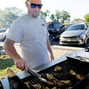 Stephen Dart, of AC's BBQ, grills hotwings for hungry guests on Saturday at the annual Emancipation Park Days at Ewert Park.<br /> Globe | Laurie Sisk