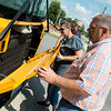 Globe/Roger Nomer<br /> Steve Cantrell and Penny Alexander examine a bus engine for explosive devices on Tuesday in Carl Junction.