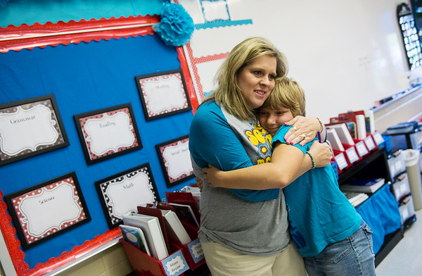 Globe/Roger Nomer<br /> Jennifer Proctor, fourth grade, gets a hug from Shelly Capps during Monday's open house at Goodman Elementary.