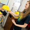 Globe/Roger Nomer<br /> Holly Nollsch, processing clerk, hands out hard hats to visitors on Thursday including Isaac Sheppard, 3, Neosho, before the groundbreaking at the Neosho Newton County Library.