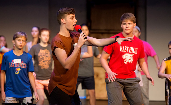 """Globe/Roger Nomer<br /> Will Jewett, a 2016 PHS grad, leads students in a routine for """"All Shook Up"""" on Monday at Pittsburg's Memorial Auditorium."""