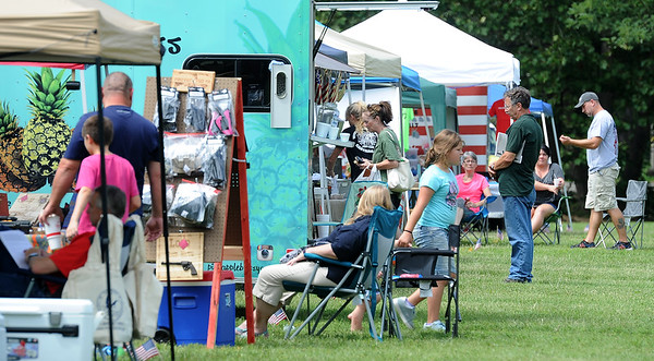 Visitors check out the various vendors during the Four States Armed Forces Music Festival on Saturday at Morse Park in Neosho. Proceeds from the event will benefit area veteran's organizations.<br /> Globe | Laurie Sisk