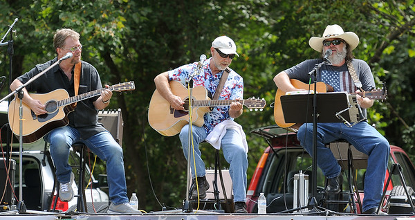 From the left: Jimmy Ahart, Denny Merritt and Lonnie Hulett entertain the crowd with some country classics during the Armed Forces Music Festival on Saturday at Morse Park in Neosho. Proceeds from the event will benefit area veteran's organizations.<br /> Globe | Laurie Sisk