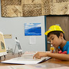 Globe/Roger Nomer<br /> Evan Shields, 10, Neosho, looks through a scrapbook of the library's history following Thursday's groundbreaking at the Neosho Newton County Library.