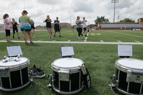 Globe/Roger Nomer<br /> Pittsburg High School band members practice drills on Monday at Hutchinson Field.