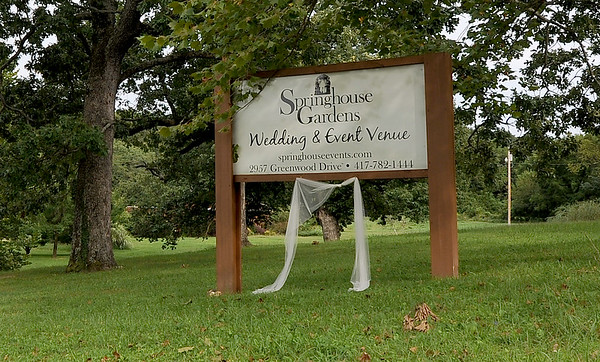 A sign at Springhouse Gardens stands near a locked gate at the venue's entrance on Tuesday.<br /> Globe | Laurie Sisk