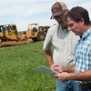 Globe/Roger Nomer<br /> John Kleiboeker talk with Dean Gulick, left, owner of D&D Drilling and Pump Service, about drilling a well on his farm near Pierce City during a meeting on Thursday.