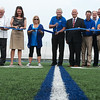 Globe/Roger Nomer<br /> David Haffner, center, helps cut the ribbon on the stadium named after him on Monday in Carthage.