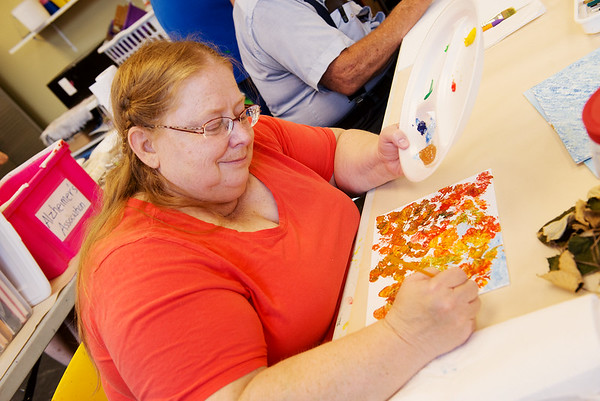 Globe/Roger Nomer<br /> Theresa Bartholet, Joplin, paints during a Memories in the Making class on Thursday at Spiva Center for the Arts.