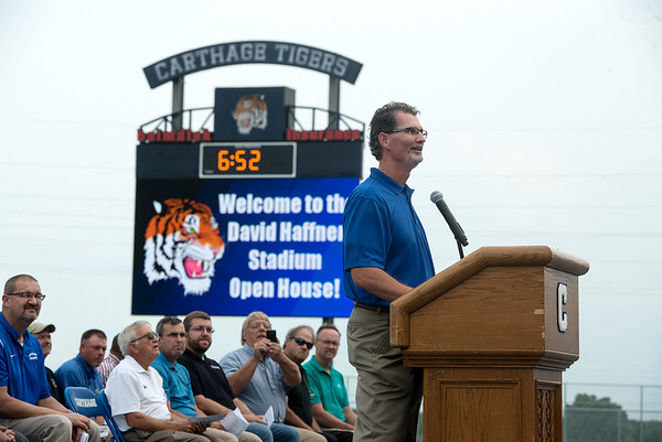 Globe/Roger Nomer<br /> Mark Baker, assistant superintendent for business at Carthage R-9 School District, introduces donors before Monday's ribbon cutting at David Haffner Stadium.