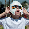 Globe/Roger Nomer<br /> Edward Seavy, 8, Joplin, marvels at the solar eclipse through custom-made glasses on Monday at the Joplin Public Library.