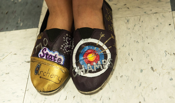 Globe/Roger Nomer<br /> Alyssa Lambeth displays her hand-made championship archery shoes from the Sarcoxie archery team.