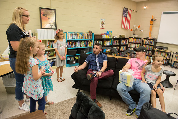 Globe/Roger Nomer<br /> Third-grade teacher Cody Crocker, center, talks with students and parents during Monday's open house in Goodman.