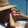 Globe/Roger Nomer<br /> Kathy and Jim Cameron take turns using eclipse glasses on Monday at the Joplin Public Library.