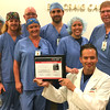Photo Courtesy of Mercy<br /> Dr. Jose De Hoyas and several members of the cardiology team represent just some of the co-workers who helped Mercy Hospital Joplin receive the American Heart Association's Mission: Lifeline® Silver Receiving Quality Achievement Award.