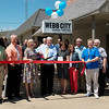Globe/Roger Nomer<br /> Steve Bearden, executive director of Ozarks New Hope, center, cuts the ribbon on the Webb City Community Health Clinic on Thursday in Webb City. Ozarks New Hope has partnered with Ozarks Community Hospital to open the clinic in downtown Webb City to provide family practice medical care for the underserved in the area.