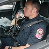 Globe/Roger Nomer<br /> Joplin Patrolman Brian Leeper checks in with dispatch on Tuesday morning in Joplin.