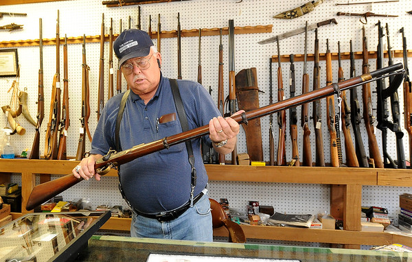 "Longtime collector W.G. ""Trip"" Triplett, of Circle T Collectibles in Carl Junction, holds a 1861 .577 caliber Tower infield musket used by confederates during the Civil War. Triplett began collecting Native American and military artifacts 71 years ago and has countless items at his store and his home.<br /> Globe 