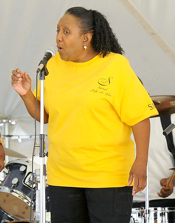 Dee Rucker, of the Spiritual Night-N-Gales, belts out a long note during sound check on Friday night at the annual Emancipation Park Days at Ewert Park.<br /> Globe | Laurie Sisk
