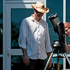 Globe/Roger Nomer<br /> Lucy Phelps, Joplin, gets an up-close view of the solar eclipse from a telescope provided by Brad Mace, Joplin, on Monday at the Joplin Public Library.
