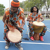 From the left: Drummers Yehalelel Byaun and Jajuan Gibson accompany the St. Louis-based dance troupe Afriky Lolo on Saturday during the annual Emancipation Park Days at Ewert Park. The traditional African dance company features youth ages three to 18 and also includes an adult troupe.<br /> Globe | Laurie Sisk