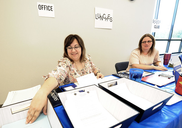 From the left: St. Mary's Elementary School Secretary Amy Oakes and Cafeteria Director Sandra Spangler organize paperwork before the start of Open House on Sunday at the school.<br /> Globe | Laurie Sisk
